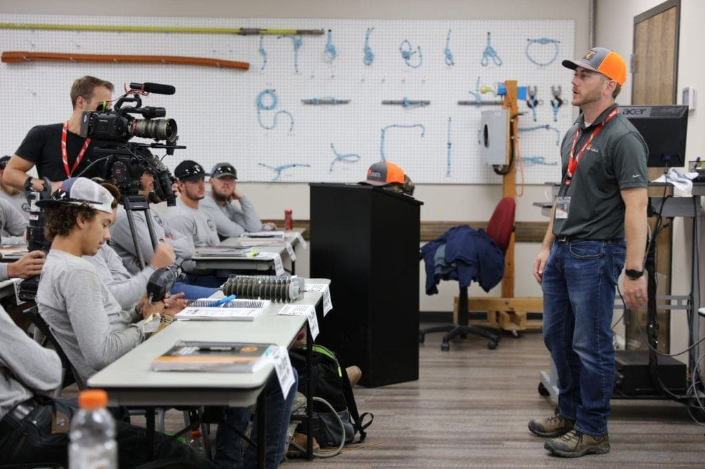 SLTC students instructed on lineman tools by Huskie reps.